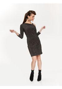 TOP SECRET - Błyszcząca sukienka odkrywająca ramię. Okazja: na imprezę. Kolor: czarny. Materiał: dzianina. Sezon: jesień, zima. Typ sukienki: asymetryczne. Styl: elegancki