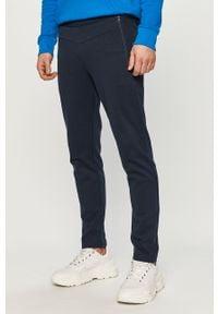 Niebieskie spodnie dresowe 4f gładkie