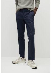 Mango Man - Spodnie Dublin. Kolor: niebieski. Materiał: tkanina. Wzór: gładki