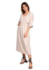 BE - Swobodna sukienka midi z szeroką gumą w pasie beżowa. Okazja: na co dzień. Kolor: beżowy. Materiał: guma. Sezon: wiosna, lato. Typ sukienki: proste. Styl: boho, casual. Długość: midi