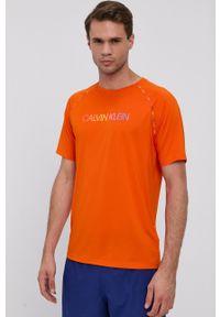 Calvin Klein Performance - T-shirt. Okazja: na co dzień. Kolor: pomarańczowy. Wzór: nadruk. Styl: casual