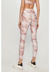 Różowe legginsy Guess z podwyższonym stanem