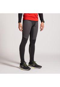 KIPRUN - Legginsy Do Biegania Męskie Kiprun Warm Rain. Materiał: materiał. Sport: fitness, bieganie