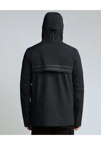 CANADA GOOSE - Czarna kurtka Nanaimo. Okazja: na co dzień. Kolor: czarny. Materiał: materiał. Długość: długie. Wzór: aplikacja. Styl: casual
