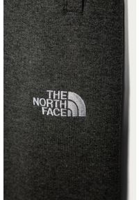 Szare spodnie dresowe The North Face melanż