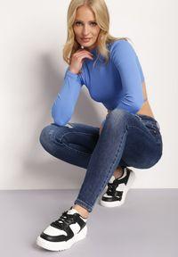 Renee - Granatowe Jeansy Push-Up Hekonia. Kolor: niebieski. Długość: długie. Wzór: aplikacja #4