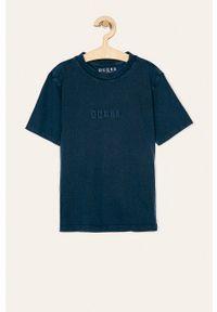 Niebieski t-shirt Guess Jeans casualowy, z aplikacjami