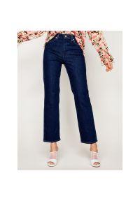 Niebieskie jeansy Wrangler retro