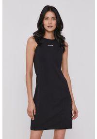 Calvin Klein Jeans - Sukienka. Kolor: czarny. Materiał: dzianina. Wzór: gładki. Typ sukienki: rozkloszowane