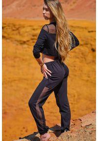 Infinite You - Czarne Dresowe Spodnie z Siateczkowym Panelem. Kolor: czarny. Materiał: dresówka