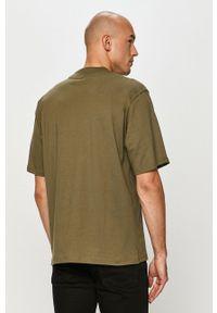 Russell Athletic - T-shirt. Okazja: na co dzień. Kolor: zielony. Materiał: dzianina. Wzór: nadruk. Styl: casual