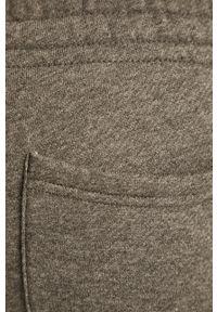 Szare spodnie dresowe New Balance melanż