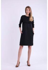 Czarna sukienka dzianinowa Nommo trapezowa