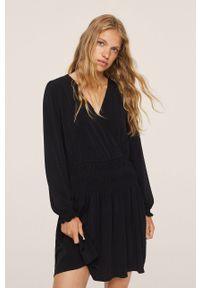 mango - Mango - Sukienka Moss1. Kolor: czarny. Materiał: tkanina. Długość rękawa: długi rękaw. Typ sukienki: rozkloszowane