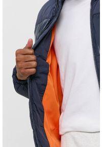 Tommy Jeans - Kurtka. Kolor: niebieski. Materiał: poliamid