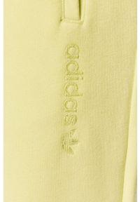 adidas Originals - Spodnie. Kolor: zielony