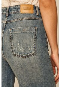 Niebieskie jeansy bootcut medicine w kolorowe wzory