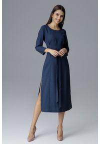 e-margeritka - Klasyczna sukienka midi wiązana w talii granat - m. Okazja: do pracy, na spotkanie biznesowe. Materiał: poliester, materiał. Typ sukienki: proste. Styl: klasyczny. Długość: midi