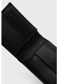 Calvin Klein - Portfel skórzany. Kolor: czarny. Materiał: materiał. Wzór: gładki
