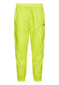 Adidas - adidas Spodnie dresowe Reverse Track GN3821 Żółty Regular Fit. Kolor: żółty. Materiał: dresówka
