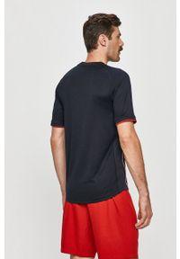 Tommy Sport - T-shirt. Okazja: na co dzień. Kolor: niebieski. Materiał: dzianina. Wzór: aplikacja. Styl: sportowy