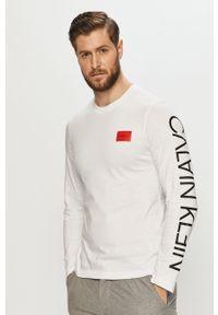 Calvin Klein - Longsleeve. Okazja: na co dzień. Kolor: biały. Długość rękawa: długi rękaw. Wzór: nadruk. Styl: casual