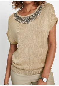 Sweter z przędzy tasiemkowej bonprix złoty metaliczny. Kolor: złoty. Wzór: aplikacja