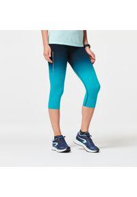 Rybaczki do biegania KIPRUN CARE damskie. Kolor: turkusowy, niebieski, wielokolorowy, czarny. Materiał: elastan, materiał, poliamid