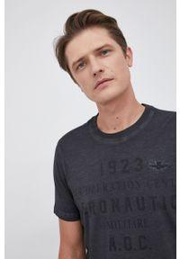 Aeronautica Militare - T-shirt bawełniany. Okazja: na co dzień. Kolor: czarny. Materiał: bawełna. Wzór: aplikacja, nadruk. Styl: casual