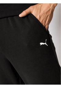 Puma Spodnie dresowe Base 599757 Czarny Regular Fit. Kolor: czarny. Materiał: dresówka