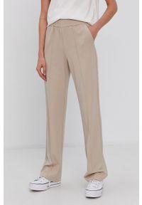 only - Only - Spodnie. Kolor: beżowy. Materiał: wiskoza, dzianina, materiał. Wzór: gładki