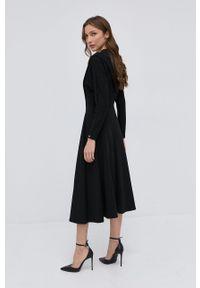 Nissa - NISSA - Sukienka. Kolor: czarny. Materiał: dzianina. Długość rękawa: długi rękaw. Wzór: gładki. Typ sukienki: rozkloszowane