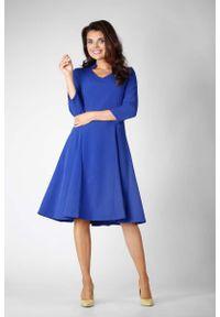Niebieska sukienka wizytowa Nommo ze stójką, wizytowa