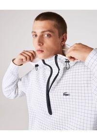 Lacoste - LACOSTE - Sportowa bluza z w kratkę. Typ kołnierza: kaptur. Kolor: biały. Materiał: dresówka, dzianina, bawełna. Wzór: kratka. Styl: sportowy