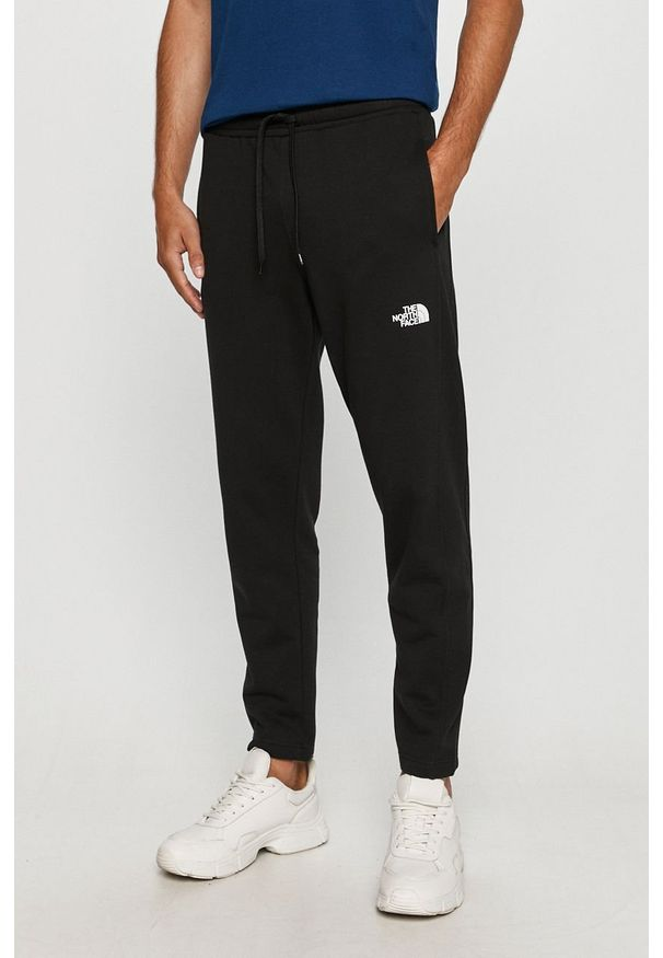 Czarne spodnie dresowe The North Face