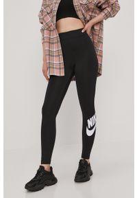 Nike Sportswear - Legginsy. Stan: podwyższony. Kolor: czarny. Wzór: nadruk