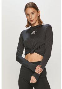 Nike Sportswear - Longsleeve. Okazja: na co dzień. Kolor: czarny. Materiał: dzianina, materiał. Długość rękawa: długi rękaw. Wzór: aplikacja. Styl: casual