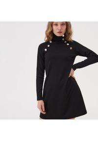 Czarna sukienka Sinsay z golfem