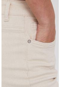 Kremowe jeansy loose fit Answear Lab wakacyjne