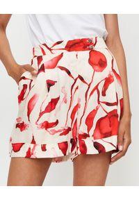 THECADESS - Spodenki z motywem kwiatowym Florence. Stan: podwyższony. Kolor: beżowy. Materiał: bawełna, jedwab. Wzór: kwiaty