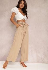 Renee - Beżowe Spodnie Szerokie Phiorephis. Kolor: beżowy. Materiał: tkanina, wiskoza, materiał. Długość: długie. Wzór: kwiaty, gładki