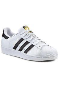 Białe buty sportowe Adidas z paskami, na co dzień