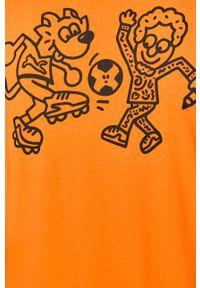 Pomarańczowy t-shirt Puma casualowy, na co dzień, z okrągłym kołnierzem, z nadrukiem