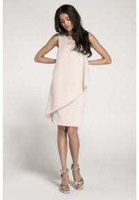 Nommo - Ołówkowa Beżowa Sukienka z Asymetryczną Nakładką. Kolor: beżowy. Materiał: wiskoza, poliester. Typ sukienki: asymetryczne, ołówkowe