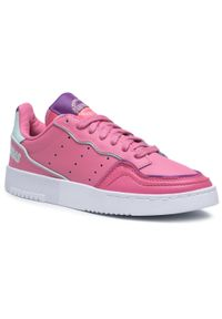 Różowe sneakersy Adidas na płaskiej podeszwie, z cholewką