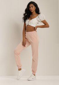 Różowe spodnie dresowe Renee
