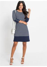 Sukienka z dżerseju w paski bonprix ciemnoniebiesko-biały w paski. Typ kołnierza: dekolt w łódkę. Kolor: niebieski. Materiał: jersey. Wzór: paski. Typ sukienki: sportowe. Styl: sportowy