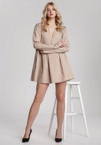 Renee - Beżowa Sukienka Genilee. Kolor: beżowy