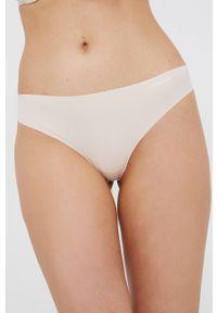 Calvin Klein Underwear - Stringi. Kolor: beżowy