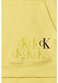 Żółta bluza nierozpinana Calvin Klein Jeans z kapturem, z nadrukiem